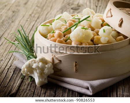 salad with cauliflower and chick-peas, healthy salad - stock photo