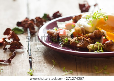 Salad with chicken and poached egg - stock photo