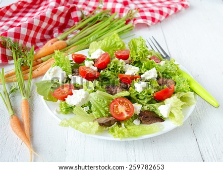 salad with chicken liver. cherry tomatoes and feta cheese - stock photo