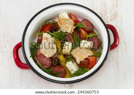 salad with chorizo, cheese and bread - stock photo