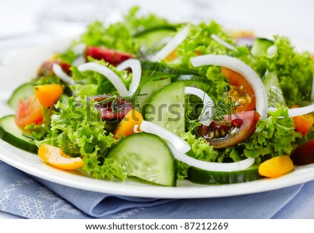 Salad with colorful cherry tomatoes - stock photo