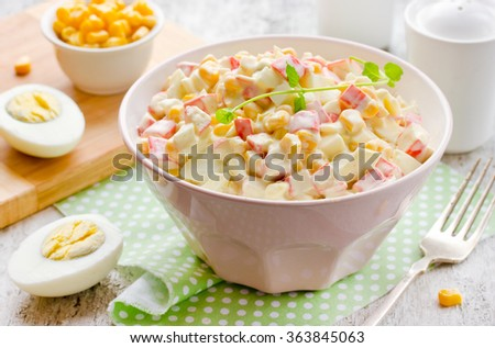 Salad with corn and crab sticks. Traditional Russian cuisine. Selective focus. - stock photo