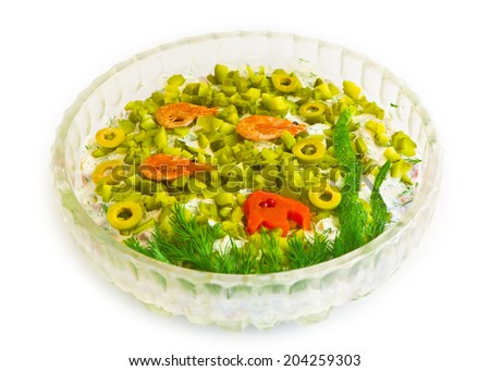 salad with cut olives, shrimps, vegetables, mayonnaise - stock photo