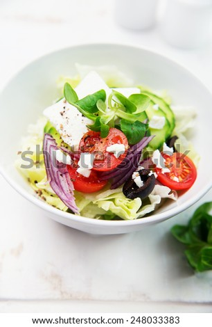 Salad with feta and olives - stock photo