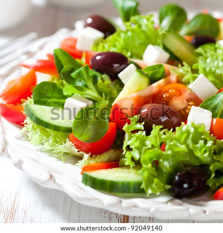 Salad with feta cheese and greek olives - stock photo
