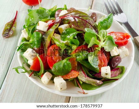 Salad with feta cheese . Selective focus - stock photo