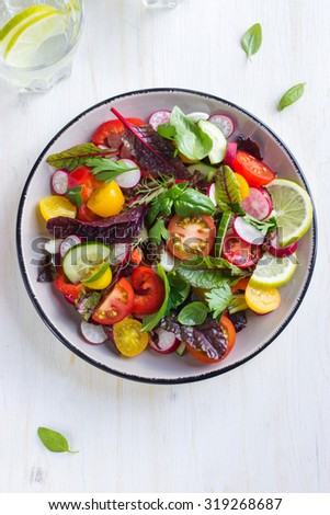 Salad with fresh summer vegetables, top view - stock photo