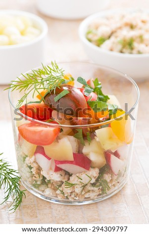salad with fresh vegetables and cottage cheese in a glass, close-up - stock photo