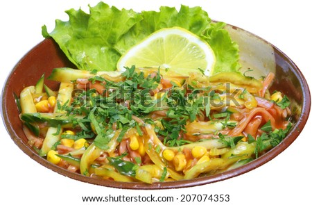 Salad with fresh vegetables and herbs (seasoned lettuce, corn, bacon, cucumbers, onions) with tomato, onion and green leaf lettuce in background. - stock photo