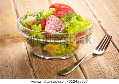Salad with fresh vegetables, tomato and cucumbers - stock photo
