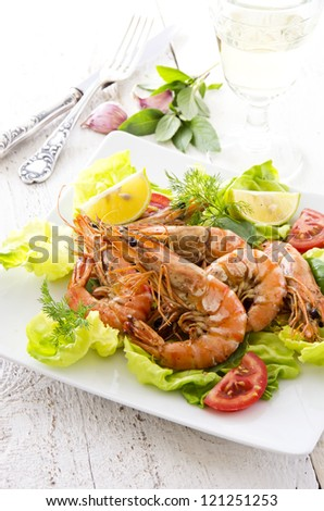 salad with fried prawns and tomatos - stock photo