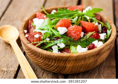 salad with grapefruit, arugula and cheese - stock photo