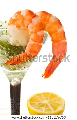 salad with greens and shrimp in a glass on a white background - stock photo