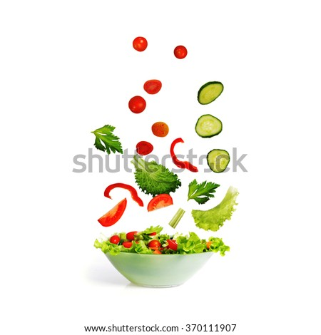 salad with lettuce and other fresh vegetable on white dish. - stock photo