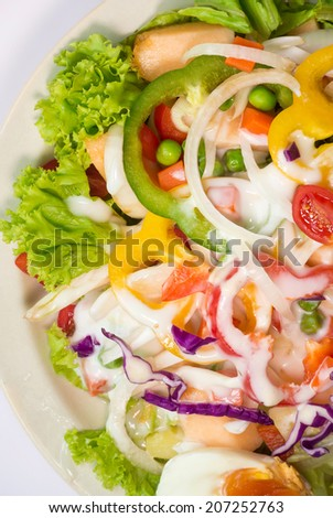 Salad with lettuce, salad cream, boiled egg and fresh vegetable close up - stock photo