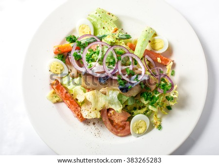 Salad with mackerel fish, zucchini, lettuce, carrots and creamy dressing  - stock photo
