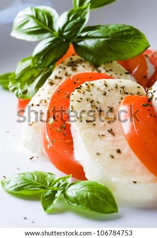 Salad with mozzarella and tomatoes - Insalata caprese - stock photo