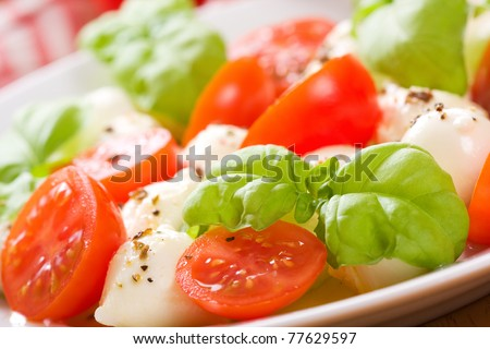 salad with mozzarella, tomatoes and basil - stock photo