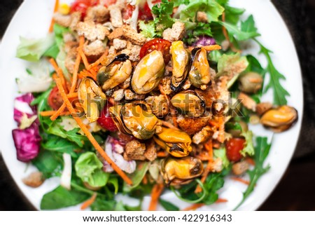 Salad with mussels and arugula / Seafood salad /Healthy Salad with arugula, tomatoes and Croutons.  - stock photo