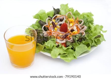 Salad with orange juice - stock photo