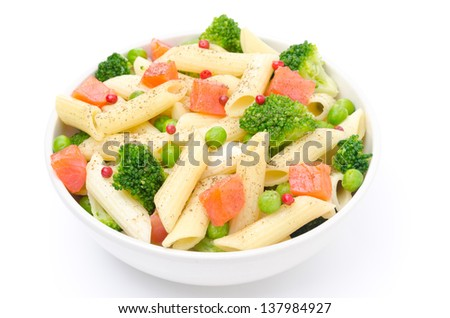 salad with pasta, smoked salmon, broccoli and green peas isolated on a white background, top view - stock photo