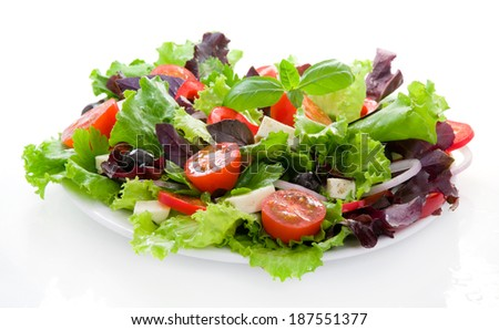 Salad with pepper, lettuce leaves and tomato - stock photo