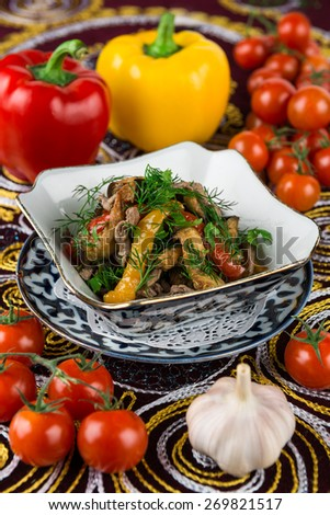 Salad with Roasted eggplant, bell pepper, beef, garlic, cilantro - stock photo