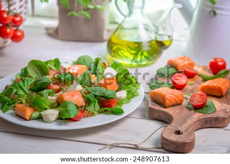 Salad with salmon, spinach and mozzarella - stock photo