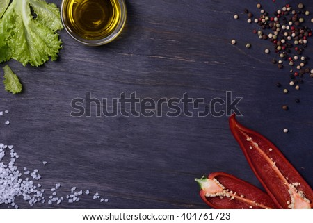 Salad with seasoning ingredients - spices, red pepper, olive oil and salt, food frame. Top view, copy space. - stock photo