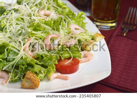 Salad with shrimps, croutons and vegetables, food still life, close up - stock photo