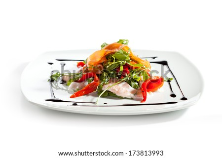 Salad with Sliced Salmon, Rucola and Paprika - stock photo