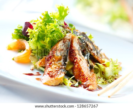 Salad With Smoked Eel with Unagi Sauce. Japanese Food - stock photo