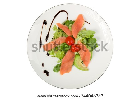 Salad with smoked salmon and avocado on - stock photo