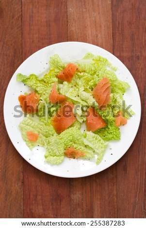 salad with smoked salmon on plate - stock photo