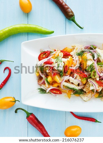Salad with steamed mackerel icefish fillet veggies and herbs. Shallow dof. - stock photo