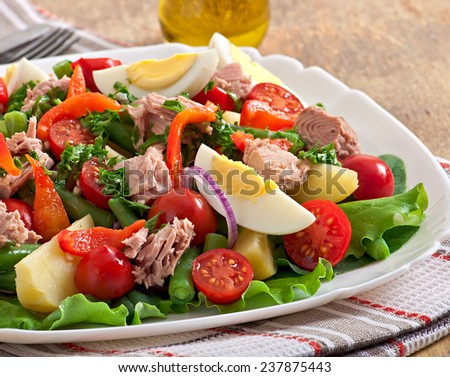 Salad with tuna, tomatoes, potato and onion - stock photo