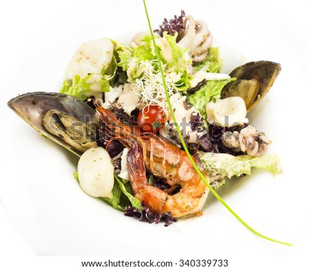 salad with vegetables and seafood on the table in a restaurant - stock photo