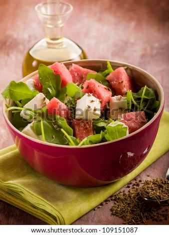 salad with water-melon, arugula feta cheese and fennel seed - stock photo