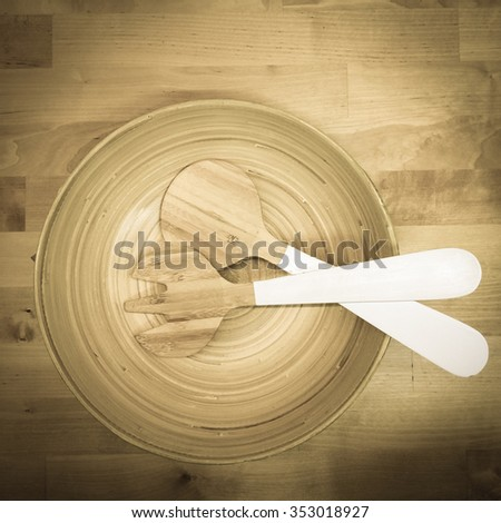 Salad wood bowl in top view - stock photo