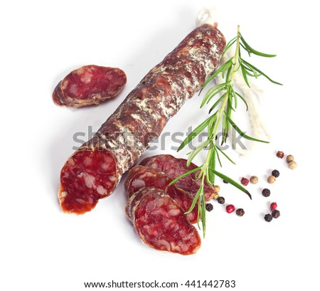 Salami sausages sliced with pepper and rosemary on white background  - stock photo