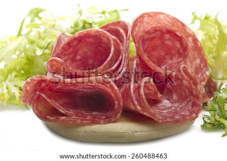 Salami sliced and bread with lattuce on white  - stock photo