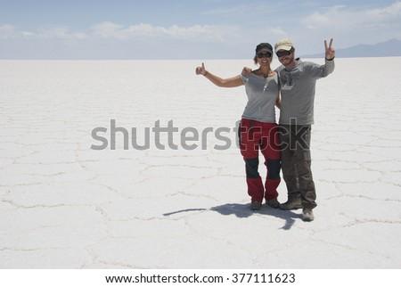 SALAR DE UYUNI, BOLIVIA - DECEMBER  08, 2008: Salar de Uyuni is largest salt flat in the World (UNESCO World Heritage Site) - Altiplano, Bolivia, South America. - stock photo