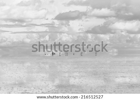 Salar de Uyuni is largest salt flat in the World (UNESCO World Heritage Site) - Altiplano, Bolivia, South America (black and white) - stock photo