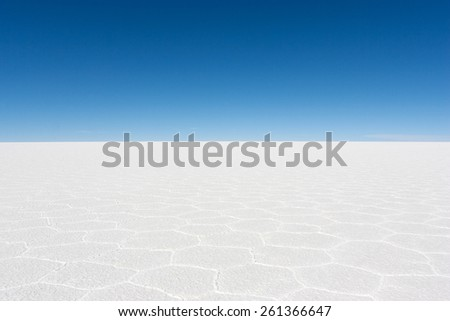 Salar de Uyuni is the world's largest salt flat located in the Daniel Campos Province in Potosi in southwest Bolivia, near the crest of the Andes. - stock photo