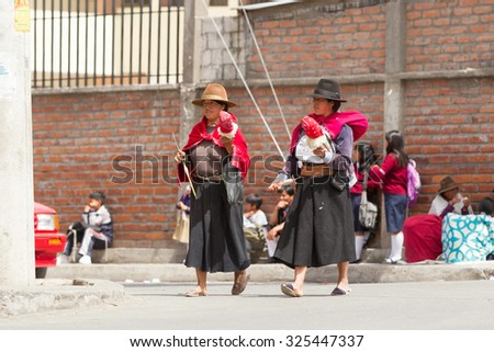 Salasaca, Ecuador - 24 January 2014: Women Spinning Alpaca Wool As Their Second Nature While Walking On The Streets In Salasaca On January 24, 2014 - stock photo