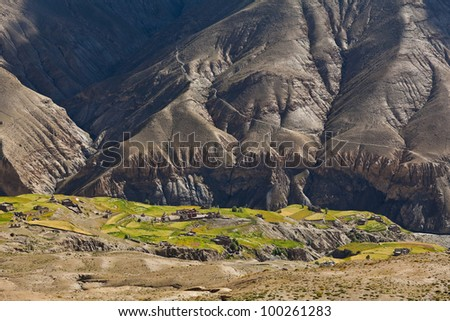Saldang Village and mountain landscape in Upper Dolpo, Nepal - stock photo