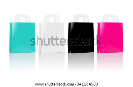 sale, consumerism, advertisement and retail concept - many blank shopping bags, blue white black pink color - stock photo