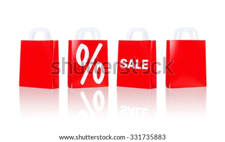 sale, consumerism, discount, advertisement and retail concept - many red shopping bags with percentage sign - stock photo