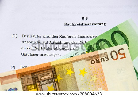 Sale contract for  house or apartment with euro bank notes - stock photo