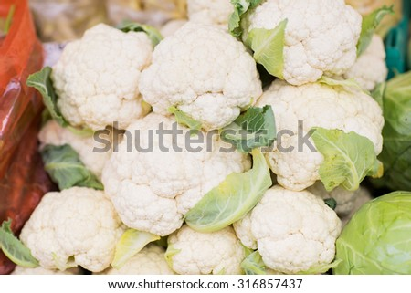 sale, harvest, food, vegetables and agriculture concept - close up of cauliflower at street market - stock photo